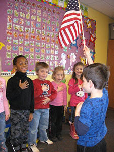 Junior Kindergarten children pledge of allegiance to the fiag of the United States