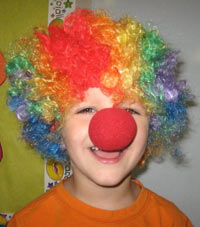 preschooler with rainbow wig and bulb nose
